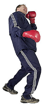 Male boxer leaning back