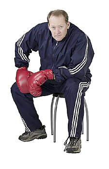 Male boxer sitting and posing