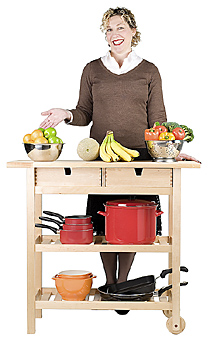 Woman proudly posing by kitchen cart