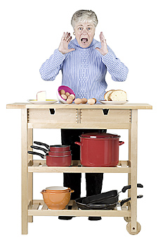 Woman standing with kitchen cart