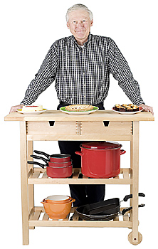 Man standing with kitchen cart