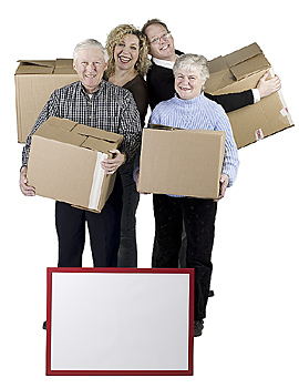 Family with moving boxes and sign