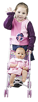 Girl pushing stroller with doll