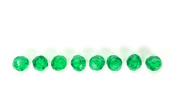 Row of sparkling green jewels
