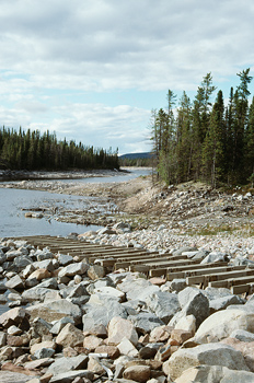 Rocky jetty on river, James Bay, Quebec, Canada