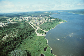 River flowing by forest, James Bay, Canada