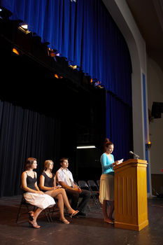 Teenagers on stage with podium