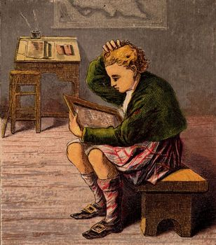 Scottish schoolboy in classroom with slate