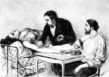 Doctor giving woman direct blood transfusion