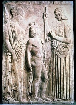 Carved relief of Demeter presenting corn to Triptolemus