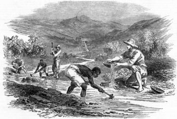 Men with slaves panning for gold in river