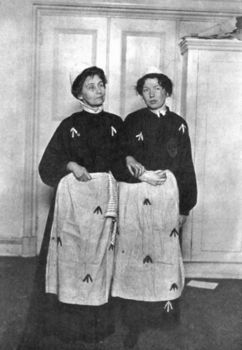 Portrait of mother and daughter suffragettes