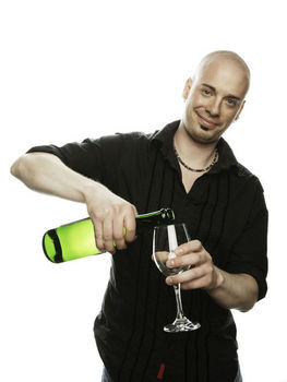 Man pouring wine into glass