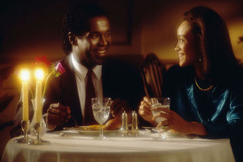 Couple sitting together at upscale restaurant