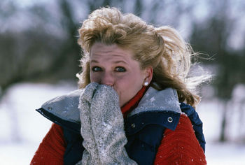 Woman shivering in the cold
