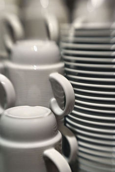 Stacks of plates and coffee cups