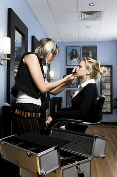 Make-up artist with client