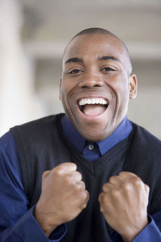 Excited man with fists clenched