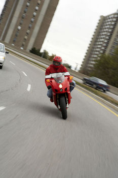 Person riding motorcycle on road