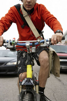 Bicycle messenger riding in traffic