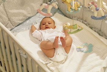 High angle view of baby in crib