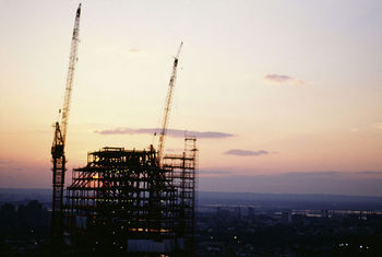 Sunset over building under construction