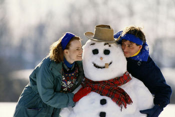 Couple outdoors with snowman