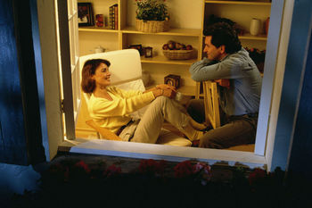 Man and woman talking inside room