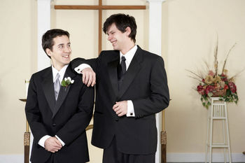 Groom and best man talking