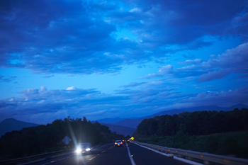 Cars on highway at dusk