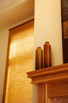 Fireplace mantle and covered window
