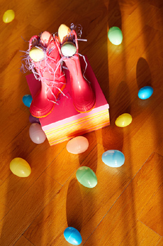 Pair of boots with scattered Easter eggs