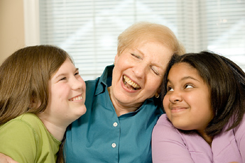 Grandmother and granddaughters laughing