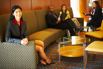 Businesswoman sitting on couch in lobby