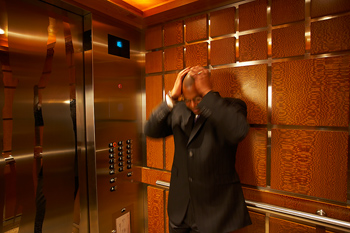 Disappointed businessman in elevator