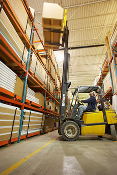 Maneuvering load in warehouse with forklift