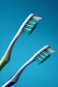 Close-up of two toothbrushes