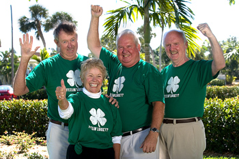 Group of people posing in identical shirts