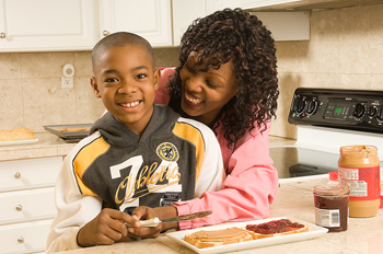 Mother and son in kitchen