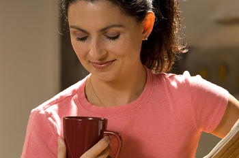 Woman at home with coffee in the morning