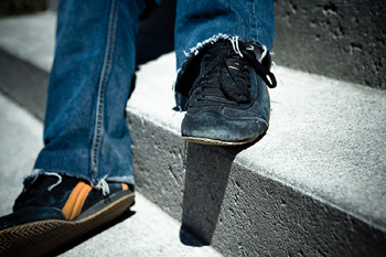 Sneakers and jeans on person outdoors