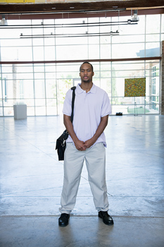 Man standing in building lobby
