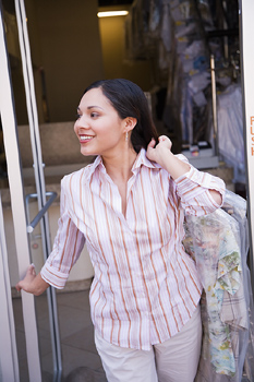 Smiling woman leaving dry cleaners