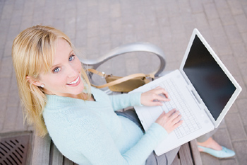High angle view of woman using laptop outdoors