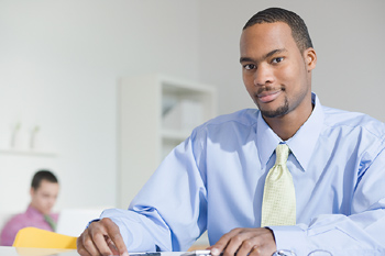 Businessman in office with others
