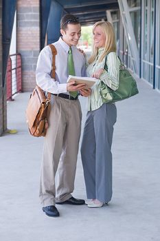 Couple standing outside looking at report