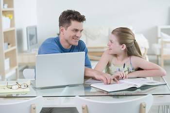 Fahter and daughter working at desk