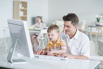 Man and boy with computer
