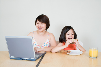 Mother and daughter at dining room table