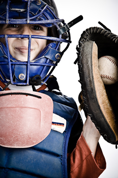 Boy with catcher's mask and glove